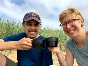Jit and I cheers-ing wiht our flask cups on Lytham St Annes beach