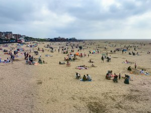 Lots of people relaxing on the beach at Lytham St Annes