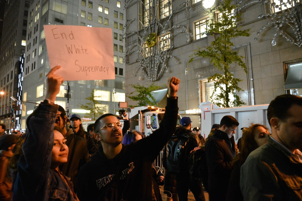 Protesters by the Trump Tower in New York City. Photo: Courtesy ofThe Urban Watch /Demi Vitkute