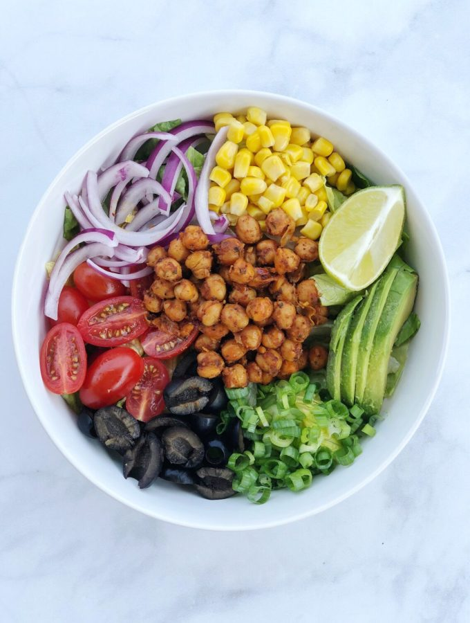 Chickpea Taco Salad is an easy vegan dish that comes together with seasoned garbanzobeans and your favorite taco toppings piled high on a bed of greens.