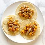 Sweet potato and white beans drizzled in lemon tahini dressing folded up in homemade tortillas will take your taco nights to the next level.