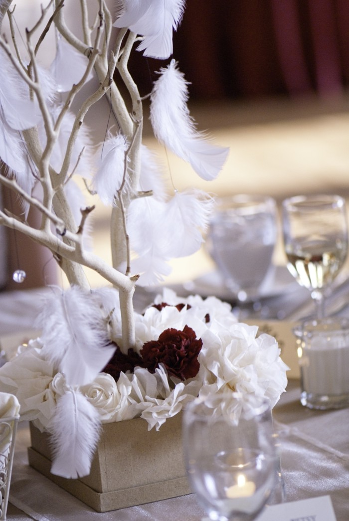branch wood feathers center table wedding ideas