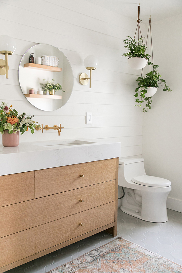 A small and modern bathroom with plants