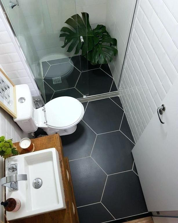 A small and modern bathroom with black floor and optimized space