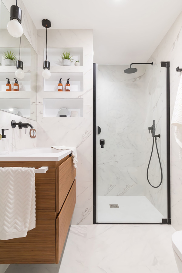 A small and modern bathroom with shower screen in matt black