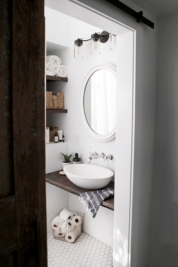 A small bathroom with a minimalist countertop