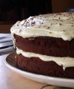 Chocolate and Ginger Cake with dribbling orange icing