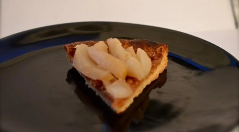 A Slice of champagne poached pear tart