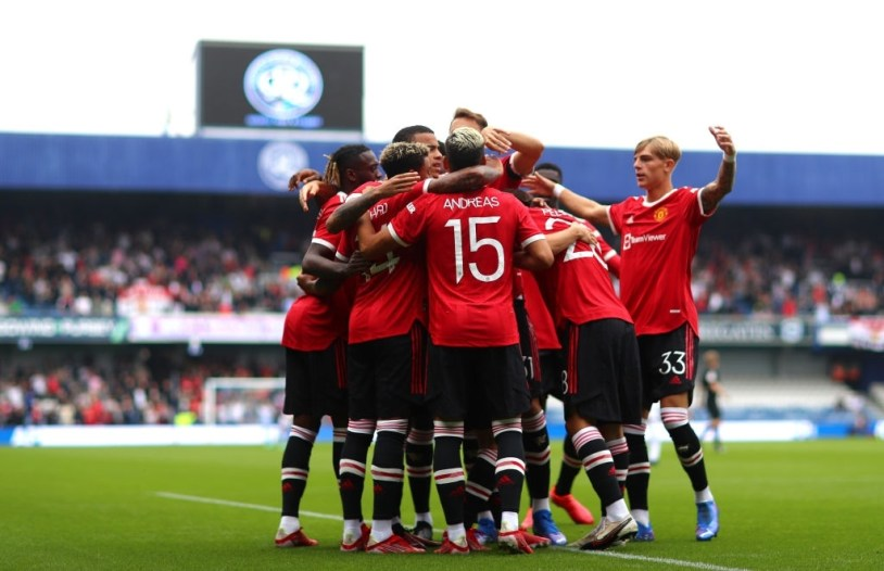 Manchester United players celebrating a goal against QPR.