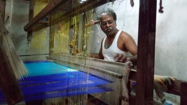 Working on the shuttle which invariably makes the silk