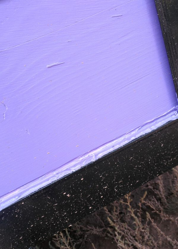 There's still two boards & a line of caulk, but it's all been painted purple now.