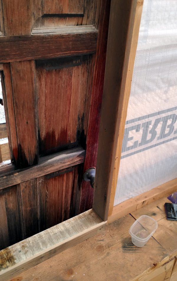 The bottom right corner of the door hole, which now has a nice doorframe made of reclaimed wood.