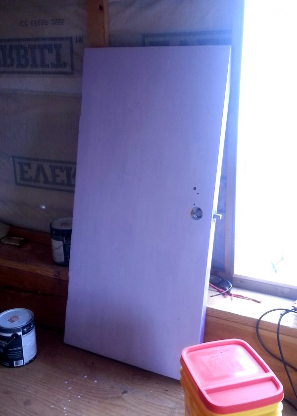 The door's leaning against Tyrava's inside wall, right next to the open doorway, & yep, it's been painted a nice lavender.