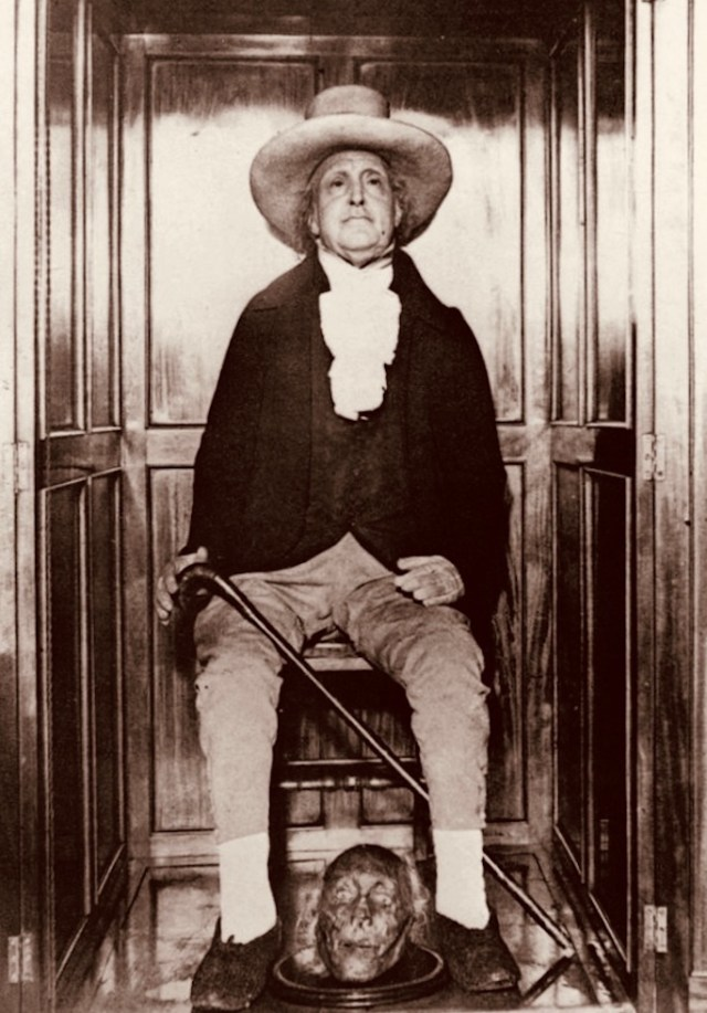Jeremy Bentham's mummified corpse with his real head at his feet.