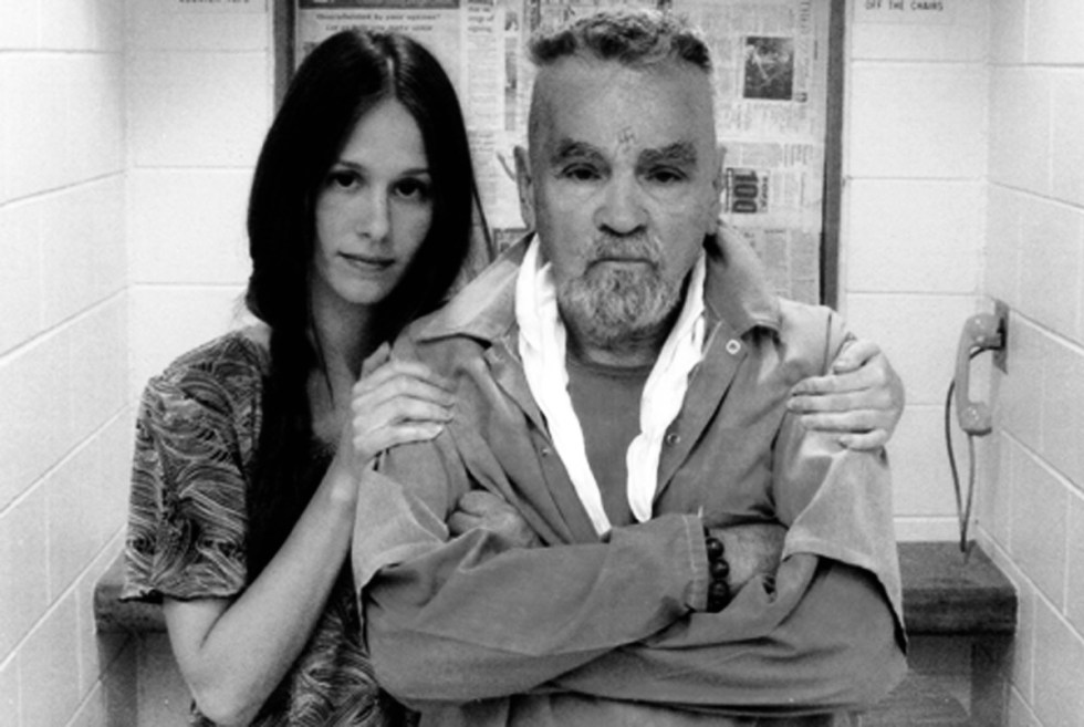 Charles Manson and his fiancée, 27-year-old Afton Elaine Burton who sought to wed him so that she could gain possession of his corpse.