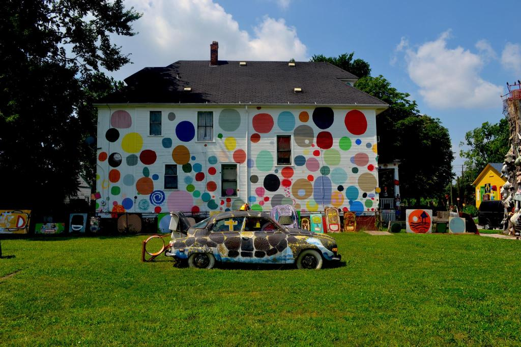 Polka-dotted house and painted car for the Heidelberg Project in Detroit, Michigan.