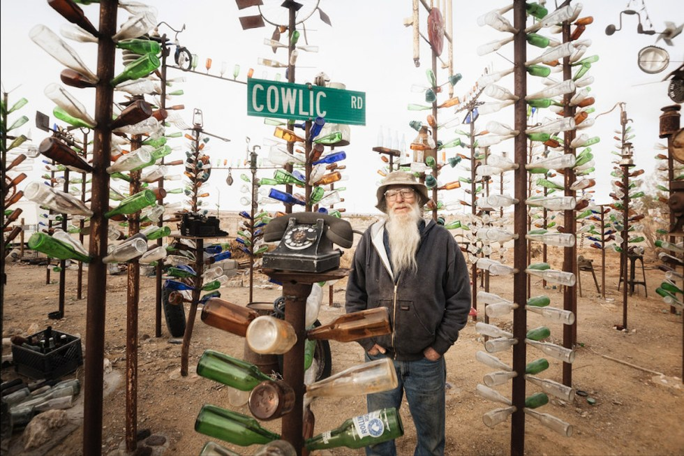 "Artist Elmer Long posing at the ""Bottle Tree Ranch"" in California, USA."