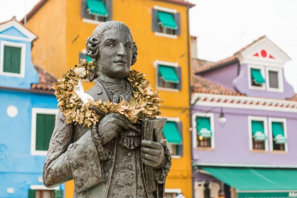 The statue of composer Baldassare Galuppi made byRemigio Barbaro in Piazza Galuppi, Burano island, Italy.