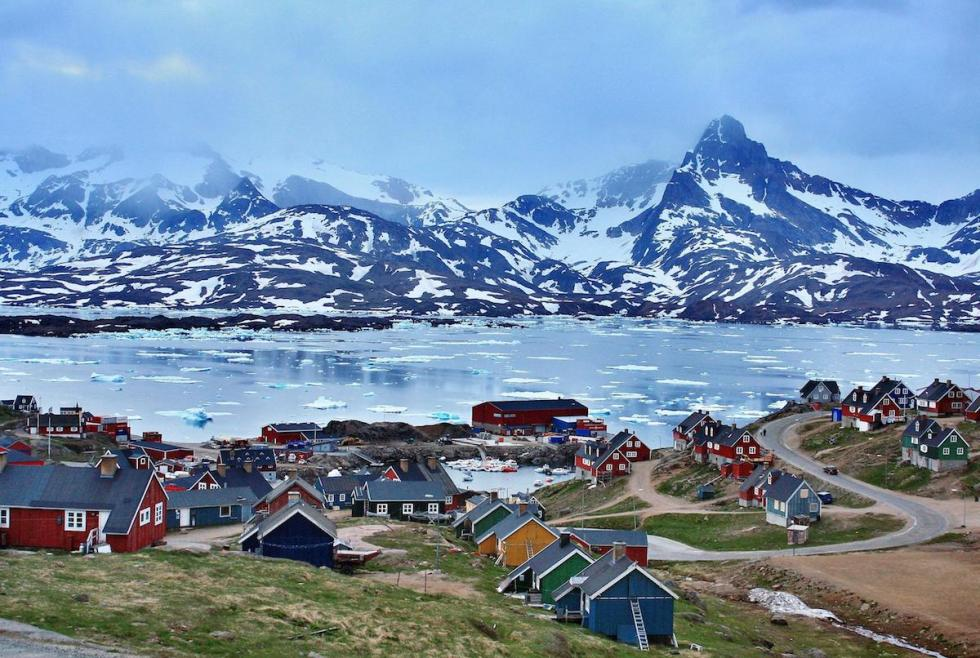 Red, green, yellow and blue wooden structures dot the town of Ittoqqortoormiit in eastern Greenland.
