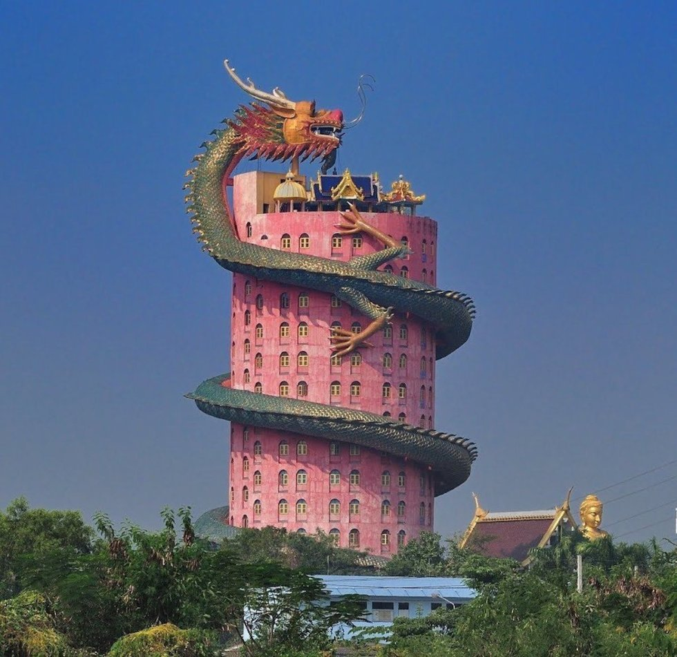 "A sculpture named ""Happiness"" tops the Wat Samphran Dragon Temple in Thailand."