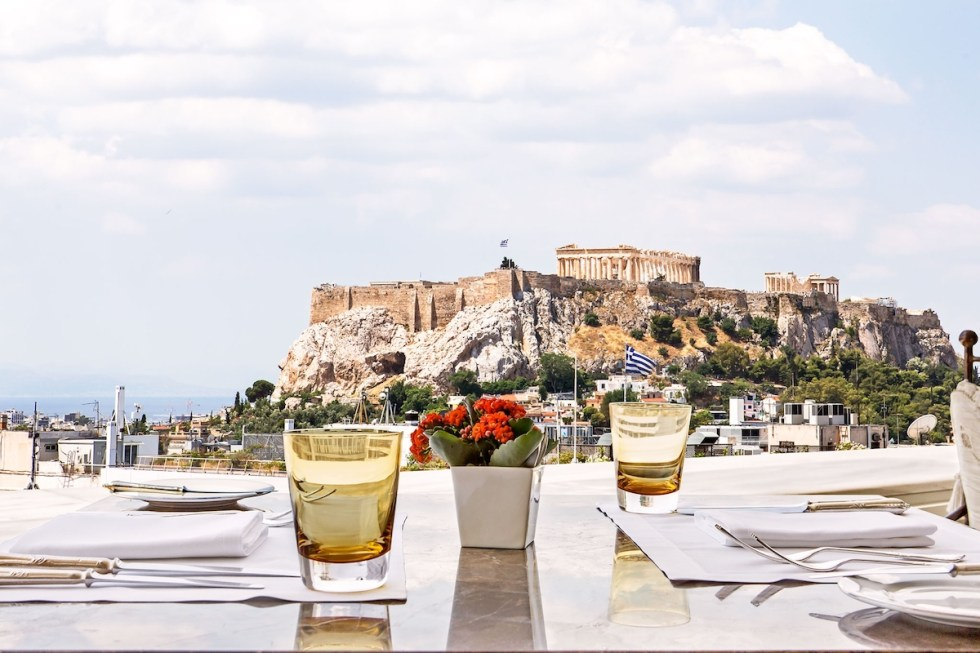Dining with a view to the Acropolis from Tudor Hall Restaurant in Athens, Greece.