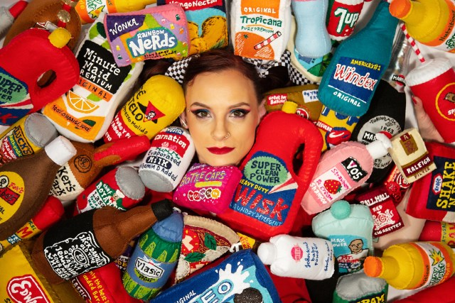 British contemporary artist Lucy Sparrow posing with her felt creations.