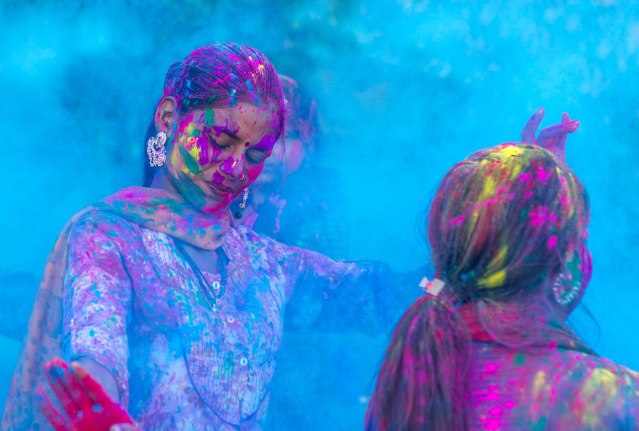 Young girls having fun during the Holi Festival of Colors celebrations in India.