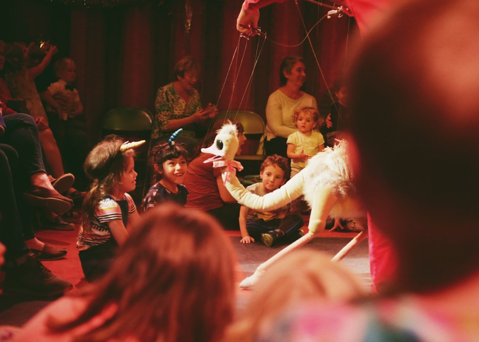 Kids having fun at Bob Baker Marionette Theater in Los Angeles, California.