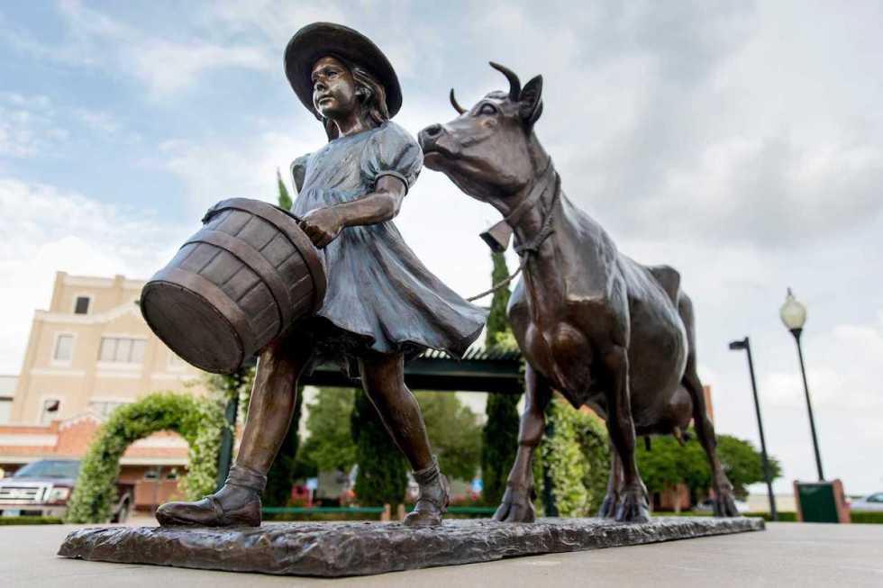 """""""Little girl leading her cow"""" just like on each Blue Bell ice cream carton, The Little Creamery, Brenham, Texas."""