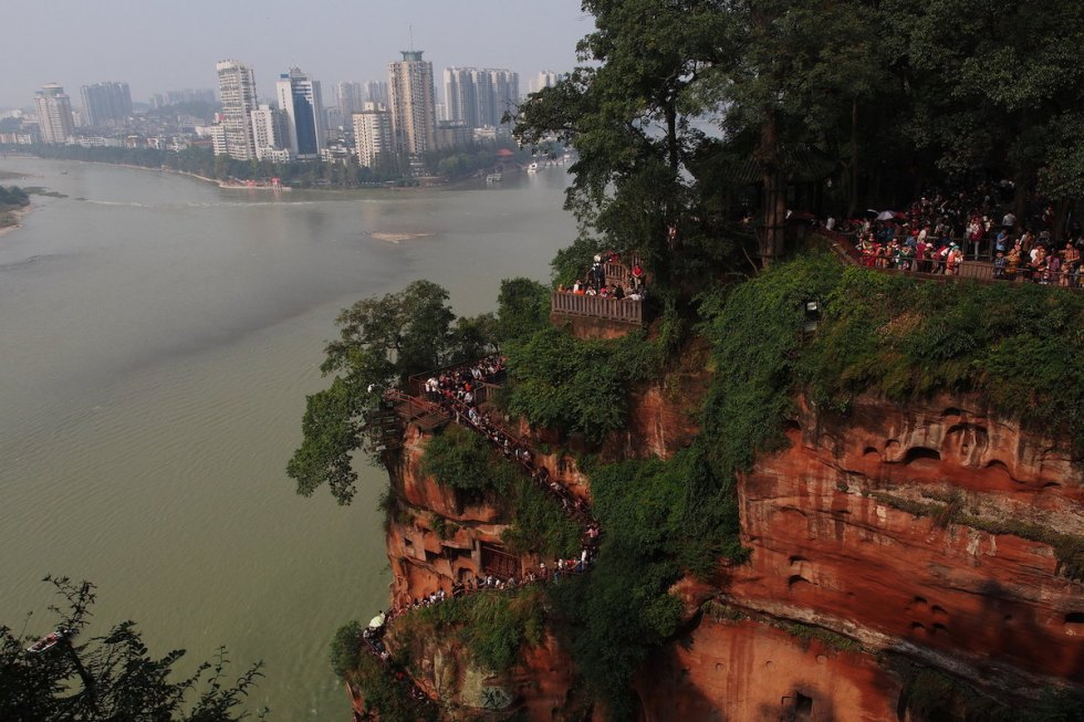 A narrow stairway bolted to the cliffside next to Leshan Giant Buddha.
