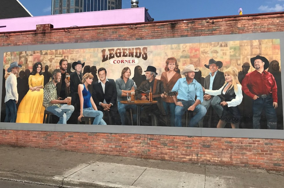 Mural of country music icons outside Legends Corner Bar in Nashville, Tennessee.
