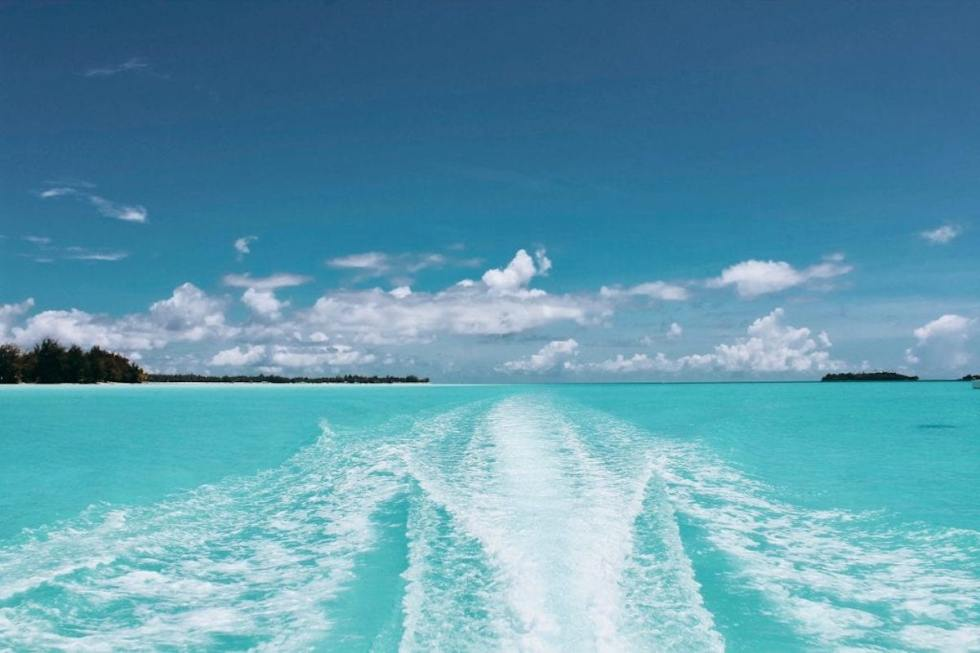 Boat floating in the crystal clear water of the Bahamas