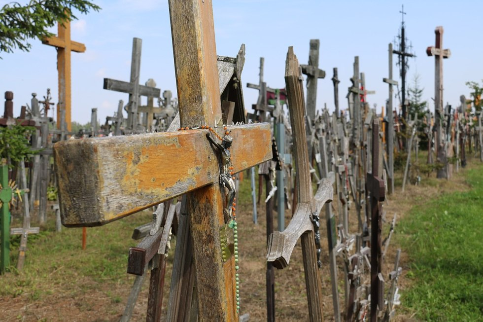 Crosses decorated with rosaries and pictures of Jesus and the saints