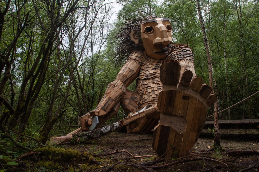 Giant troll carving his dreams into ancient tree
