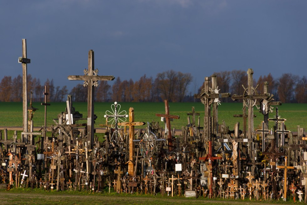 Crosses of all shapes and sizes on Kryzių Kalnas decorated with pictures of Jesus and the saints, rosaries, and photographs of Lithuanian patriots