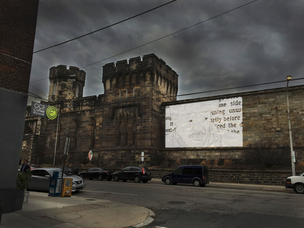 Film projected onto the façade of historic prison-turned-museum in Philadelphia, Pennsylvania