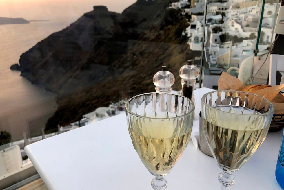 Incredible Santorini views drinking wine at Mpriki Restaurant in Santorini