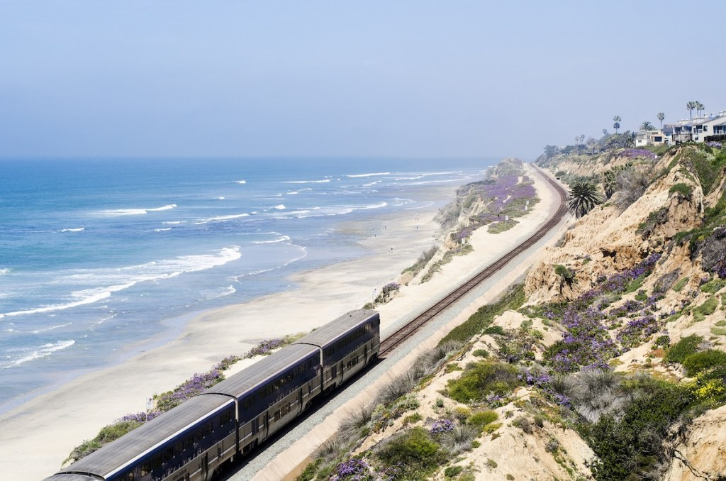 Commuter train providing breathtaking coastal scenery as it runs through San Diego County