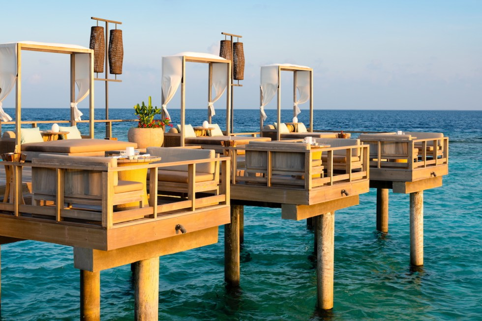 Lagoon Bar, a stylish venue above the crystal waters with open-air lounging space and Indian Ocean breezes