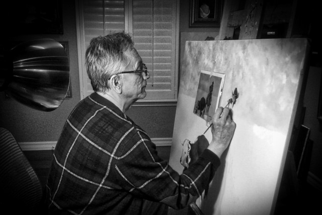 Impressionist artist Alberto Escamilla painting a southwestern scene in his El Paso studio