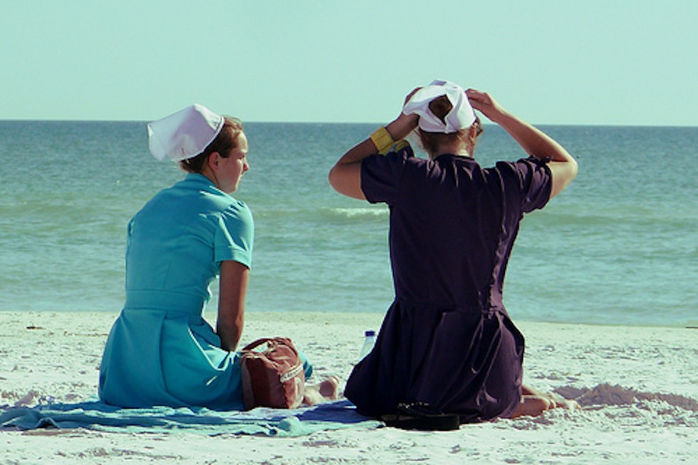 Amish women on the beach