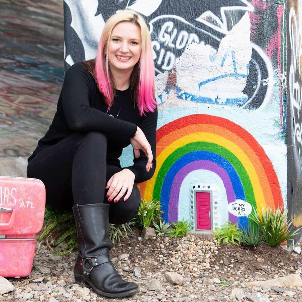 Karen Anderson Singer posing next to Door #2: Old Fourth Ward Skatepark on the BeltLine