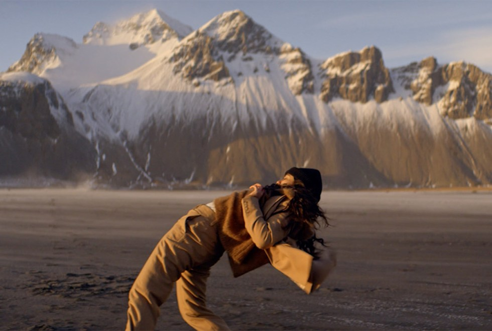 """""""F Major"""" music video snapshot depicting a woman dancing with an unreal Icelandic landscape in the background"""