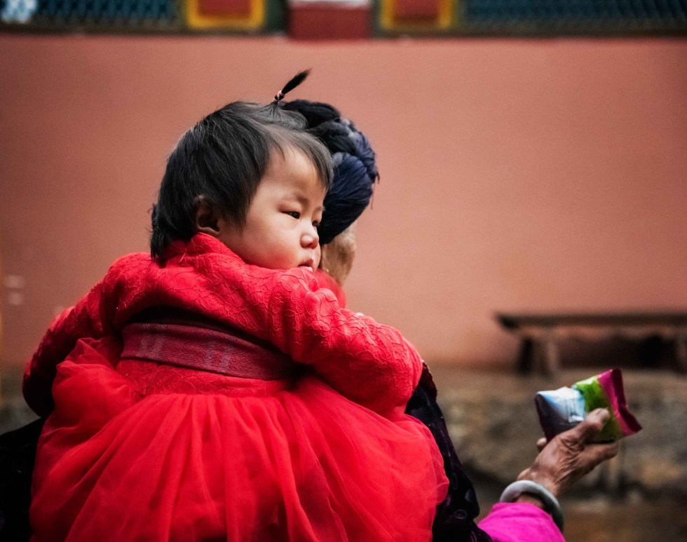 Mosuo girl with her grandmother in Yunnan, China