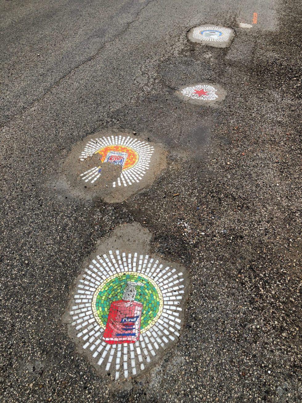 pandemic-themed pothole mosaics