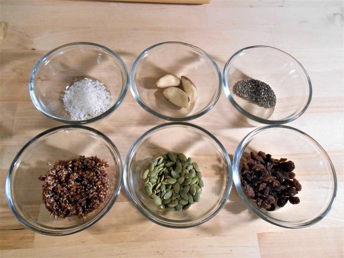oatmeal bowl ingredients, chia seeds, coconut flakes, quinoa, raisins, vegan bowl
