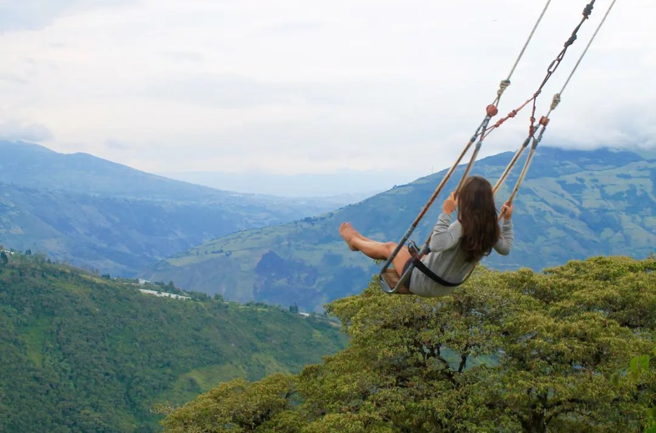 The swing at the end of the world at La Casa del Arbol in Baños.