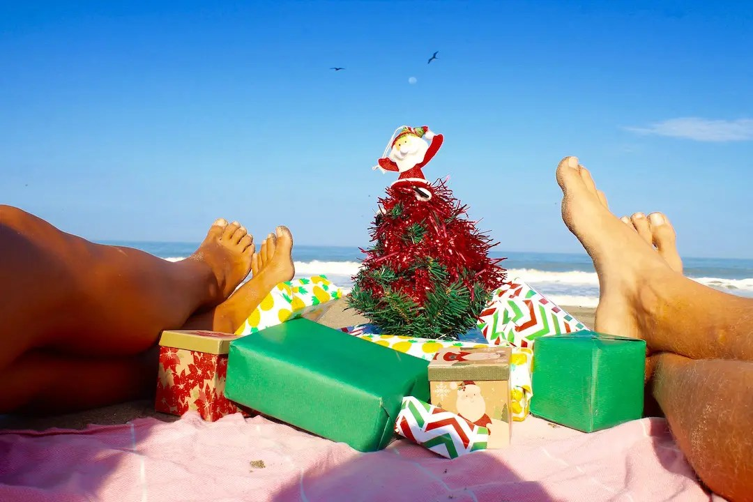 Christmas tree with presents at our feet at the beach