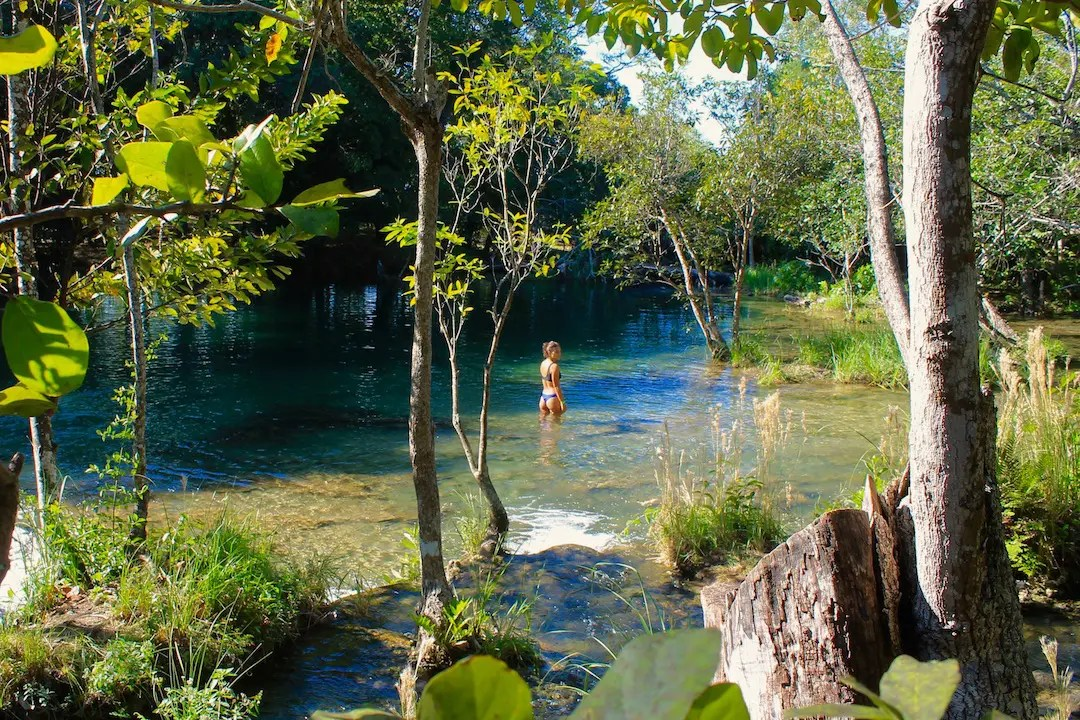 A girl wading in the series of pools at the Lagos de Colon in Chiapas. Lago de Colon are a special highlight of a Chiapas Road Trip.