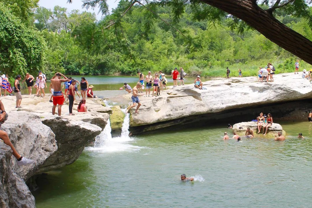 Kids jumping into the river at McKinney Falls State Park